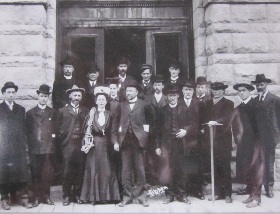 A faded photo tacked on the wall of EP's hut, showing the lady of the day with the other founding members of the ACC.